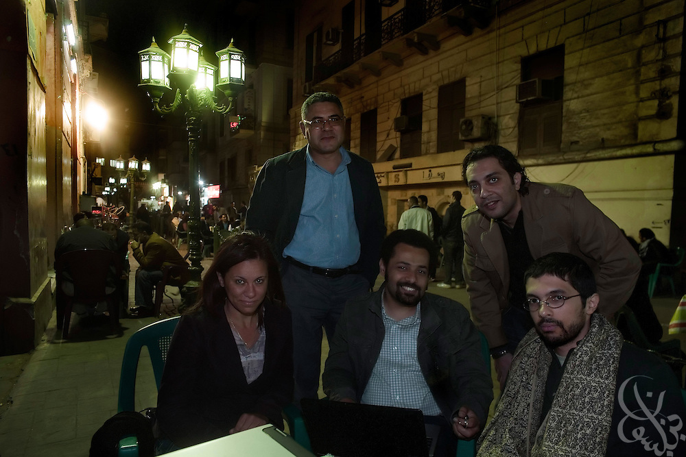 Gamal Eid, (back,l) executive director of the Arabic Network for Human Rights Information meets with Egyptian bloggers (from left to right)  Shahinaz Abdel Salem, Wael Abbas, Mohamed Khaled,and Ahmed Garbeia  March 08, 2009 at a street cafe popular with political activists in downtown Cairo, Egypt. Eid works closely advising and representing Egyptian bloggers legally, as many have faced increased political pressure and in some cases even detention, arrest or trial in cases where their writing has angered the Egyptian government.