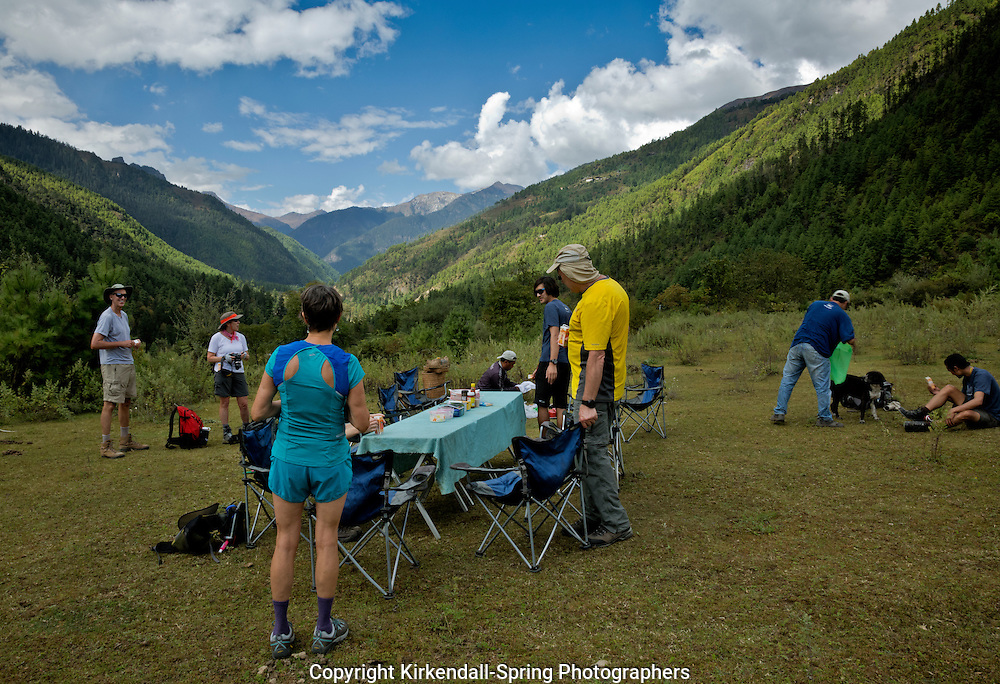 BU00146-00...BHUTAN - Trekkers stop for a stumpuous lunch in the Paro River Valley on their way to the first camp of the Jhomolhari 2 Trek.