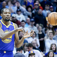 13 February 2017: Golden State Warriors forward Kevin Durant (35) passes the ball during the Denver Nuggets 132-110 victory over the Golden State Warriors, at the Pepsi Center, Denver, Colorado, USA.