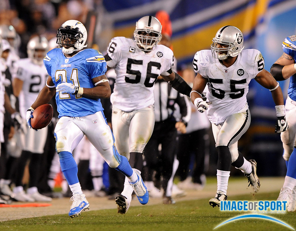 Dec 4, 2008; San Diego, CA, USA; San Diego Chargers running back LaDainian Tomlinson (21) is pursued by Oakland Raiders linebacker Derrick Burgess (56) and Jon Alston (55) in the second half at Qualcomm Stadium. The Chargers defeated the Raiders 34-7.
