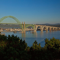 The Yaquina Bay bridge at sunset, spans Yaquina Bay in the city of Newport, Oregon on US 101.