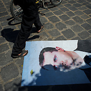 August 14, 2012 - Aleppo, Syria: A local resident passes over a picture of the president Bashar Al-Assad in Babal Nassar neighborhood in Aleppo's old city. The Syrian Army have in the past ten days increased their attacks on residential neighborhoods where Free Syria Army rebel fights have their positions in Syria's commercial capital, Aleppo. (Paulo Nunes dos Santos/Polaris)