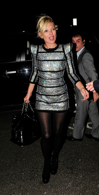 22.APRIL.2009 - LONDON<br /> <br /> SUPERMODEL KATE MOSS ARRIVING AT THE MILLBANK CENTER, SOUTHBANK WITH DAVID WALLIAMS FOR A PREVIEW OF MATTHEW WILLAMSON'S NEW H&amp;M COLLECTION WEARING A SPACE AGE SILVER DRESS, SHE ONLY STAYED FOR 15 MINUTES BEFORE LEAVING AND HEADING TO NOBU RESTAURANT, BERKLEY SQUARE TO MEET FRIENDS RHYS EVANS, BOBBY GILLESPIE, JEFFERSON HACK, JAMES BROWN AND DAVE GARDNER FOR A FRIENDS BITRTHDAY SHE STAYED THERE TILL 12.30AM AND HEADED ONTO MOVIDA CLUB WHERE THEY ALL PARTIED TILL 4.00AM AND LEFT LOOKING WORSE FOR WEAR.<br /> <br /> BYLINE MUST READ : EDBIMAGEARCHIVE.COM<br /> <br /> *THIS IMAGE IS STRICTLY FOR UK NEWSPAPERS &amp; MAGAZINES ONLY*<br /> *FOR WORLDWIDE SALES OR WEB USE PLEASE CONTACT EDBIMAGEARCHIVE - 0208 954-5968*