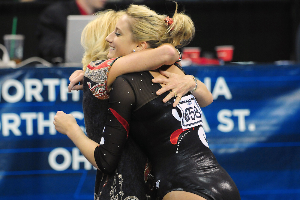 University of Utah freshman Mary Beth Lofgren gets a hug from coach Megan Marsden after Lofgren's balance beam routine at the 2011 Women's NCAA Gymnastics Championship Individual Event Finals on April 17, in Cleveland, OH. Lofgren tyied for for fifth place(photo/Jason Miller)