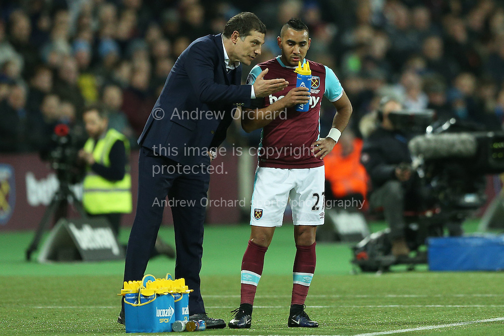 Slaven Bilic, the West Ham United manager speaks  to Dimitri Payet of West Ham United during a break in play. Premier league match, West Ham Utd v Arsenal at the London Stadium, Queen Elizabeth Olympic Park in London on Saturday 3rd December 2016.<br /> pic by John Patrick Fletcher, Andrew Orchard sports photography.