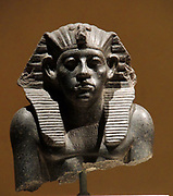 Head of a statue of King Amenemhet 111with king's head-cloth,12th Dynasty about 1840 BC. Granite
