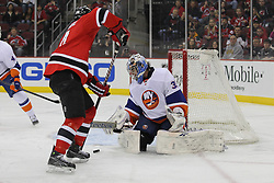 Apr 3; Newark, NJ, USA; New York Islanders goalie Al Montoya (35) makes a save on New Jersey Devils center Adam Henrique (14) during the second period at the Prudential Center.