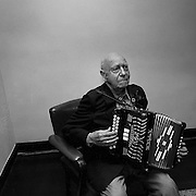 Retired mine labourer, 89 year old Willie Ciccone, playing the accordion at the Dante Club, Timmins, Ontario. From the book Cage Call: Life and Death in the Hard Rock Mining Belt. An in-depth project spanning over 12-years examining communities in one of the richest mining regions in the world located in Northwestern Ontario and Northeastern Quebec in Canada.