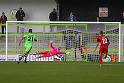 Save from Forest Green Rovers goalkeeper Sam Russell(23) during the Vanarama National League match between Forest Green Rovers and Barrow at the New Lawn, Forest Green, United Kingdom on 1 October 2016. Photo by Shane Healey.