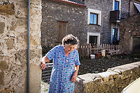 ACCIAROLI (POLLICA), ITALY - 5 OCTOBER 2016: 82-years old Fenisia La Greca steps out of her vegetable garden next to her house in Acciaroli, a hamlet in the municipality of Pollica, Italy, on October 5th 2016. Fenisia La Greca grows fruit and vegetables in her own garden.<br /> <br /> To understand how people can live longer throughout the world, researchers at University of California, San Diego School of Medicine have teamed up with colleagues at University of Rome La Sapienza to study a group of 300 citizens, all over 100 years old, living in Acciaroli (Pollica), a remote Italian village nestled between the ocean and mountains in Cilento, southern Italy.<br /> <br /> About 1-in-60 of the area's inhabitants are older than 90, according to the researchers. Such a concentration rivals that of other so-called blue zones, like Sardinia and Okinawa, which have unusually large percentages of very old people. In the 2010 census, about 1-in-163 Americans were 90 or older.