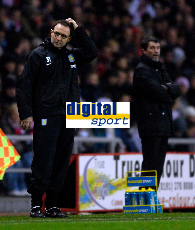 Photo: Jed Wee/Sportsbeat Images.<br /> Sunderland v Aston Villa. The FA Barclays Premiership. 15/12/2007.<br /> <br /> Aston Villa manager Martin O'Neill (L) scratches his head as Sunderland manager Roy Keane looks on.