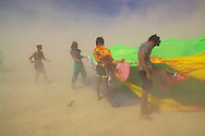 BLACK ROCK CITY, NV:  Participants of Burning Man attempt to set up a giant inflatable brain in the middle of a dust storm in Black Rock City, Nevada. High winds and extreme temperatures are two of the obstacles that face every member of Black Rock City during the festival.