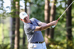 Rick Neuheisel tees off on the 10th hole during the Chick-fil-A Peach Bowl Challenge at the Ritz Carlton Reynolds, Lake Oconee, on Tuesday, April 30, 2019, in Greensboro, GA. (Karl L. Moore via Abell Images for Chick-fil-A Peach Bowl Challenge)