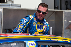 STOCKTON, CA - MAY 4: Eric Holmes, driver of the #20 NAPA / Almond Ace Packing Toyota, exits his car during practice for the NASCAR K&N Pro Series West G-Oil 150 at the Stockton 99 Speedway on May 4, 2013 in Stockton, California. (Photo by Jason O. Watson/Getty Images for NASCAR) *** Local Caption *** Eric Holmes