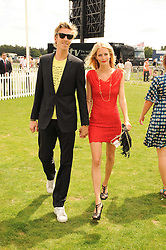 JAMES COOK and POPPY DELEVINGNE at the Cartier International Polo at Guards Polo Club, Windsor Great Park, Berkshire on 25th July 2010.