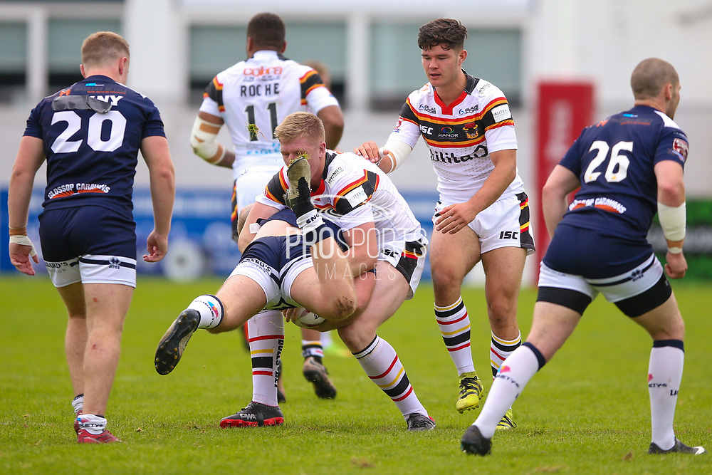 Bradford Bulls prop Liam Kirk (8) tackles Swinton Lions Ben Austin (18)  during the Kingstone Press Championship match between Swinton Lions and Bradford Bulls at the Willows, Salford, United Kingdom on 20 August 2017. Photo by Simon Davies.