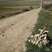 Path near Santo Domingo de la Calzada, La Rioja. Spain . The WAY OF SAINT JAMES or CAMINO DE SANTIAGO following the French Route, between Saint Jean Pied de Port and Santiago de Compostela in Galicia, SPAIN. Tradition says that the body and head of St. James, after his execution circa. 44 AD, was taken by boat from Jerusalem to Santiago de Compostela. The Cathedral built to keep the remains has long been regarded as important as Rome and Jerusalem in terms of Christian religious significance, a site worthy to be a pilgrimage destination for over a thousand years. In addition to people undertaking a religious pilgrimage, there are many travellers and hikers who nowadays walk the route for non-religious reasons: travel, sport, or simply the challenge of weeks of walking in a foreign land. In Spain there are many different paths to reach Santiago. The three main ones are the French, the Silver and the Coastal or Northern Way. The pilgrimage was named one of UNESCO's World Heritage Sites in 1993. When there is a Holy Compostellan Year (whenever July 25 falls on a Sunday; the next will be 2010) the Galician government's Xacobeo tourism campaign is unleashed once more. Last Compostellan year was 2004 and the number of pilgrims increased to almost 200.000 people.