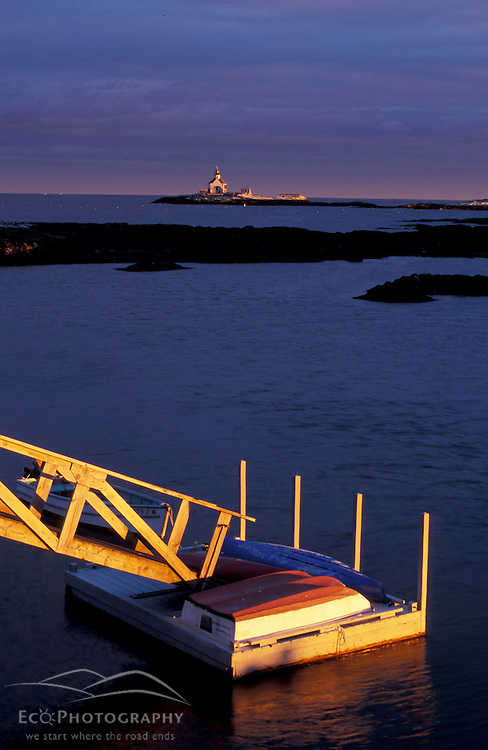 Southport Island, ME.... Boats on a dock at the southern end of Southport Island.  Cuckolds Lighthouse is in the distance.  Boothbay Harbor