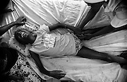 Vivien Massomba, 12, who suffers from palsy following a polio infection, grimaces while being massaged by a health worker at the Tie-Tie hospital in Pointe-Noire, Republic of Congo, on Thursday December 2, 2010.