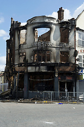 © Licensed to London News Pictures. 09/08/2011. London, UK. The empty shell of a burnt out building on the corner of St. James Road and London Road, Croydon following last night's riots. Photo credit : Mary Stamm-Clarke/LNP