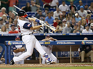 March 12, 2017 - Miami, FL, USA - United States catcher Buster Posey hits a solo home run during the seventh inning of a World Baseball Classic first round Pool C game against Canada on Sunday, March 12, 2017 at Marlins Park in Miami, Fla. (Credit Image: © David Santiago/TNS via ZUMA Wire)