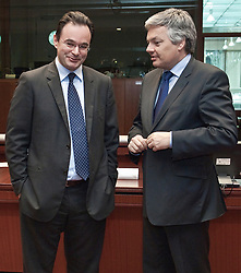 George Papaconstantinou, Greece's finance minister, left, speaks with Didier Reynders, Belgium's finance minister, during the emergency meeting of European Union finance ministers in Brussels, Belgium, on Sunday, May 9, 2010.  European Union finance ministers meet today to hammer out the details of an emergency fund to prevent a sovereign debt crisis from shattering confidence in the 11-year-old euro. (Photo © Jock Fistick)