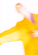 Blur of woman in yellow