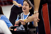 """Kellogg Foundation Assignment: Wheelchair Basketball..Keaton Shoemaker laughs as he gets a hi-five...The contact is Pam Patula, 888/957-6245 runs an organization.called Socil (S.E. center for Independent Living )a member of April.  A weekly wheelchair basketball game in Lancaster, held on Jan 20th. Saturday at 10am. The basketball coach, Brett Harbage, is an Independent Living Specialist from SOCIL.  Other coach is Cheryl """"Hutch"""" Hutchinson, she is the adaptive physical education instructor of Fairfield County.  The adaptive basketball games are part of the Upward Basketball league, .  This is only Upwards adaptive league in the nation."""