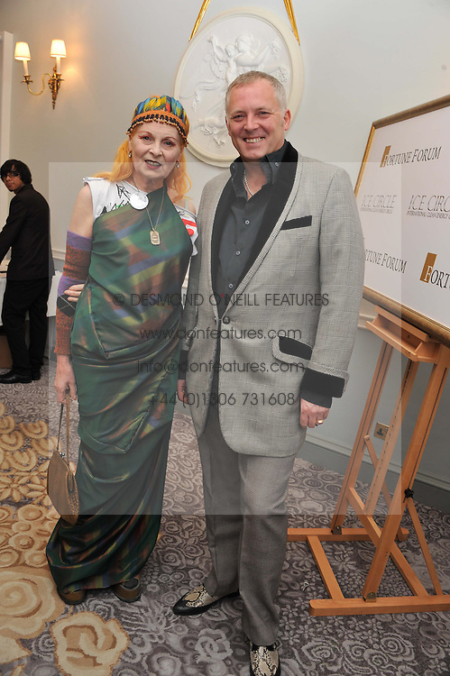 DAME VIVIENNE WESTWOOD and JOSEPH CORRE at the 4th Fortune Forum Summit held at The Dorchester Hotel, Park Lane, London on 4th December 2012.