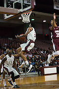 Chris Thomas of TSU blows past Nicolas West a Alabama A&M defender for a layup. TSU defeats Alabama A&M 77-54 at the HP&E Arena in Houston, Texas. Photo By: Jerome Hicks/ Space City Images