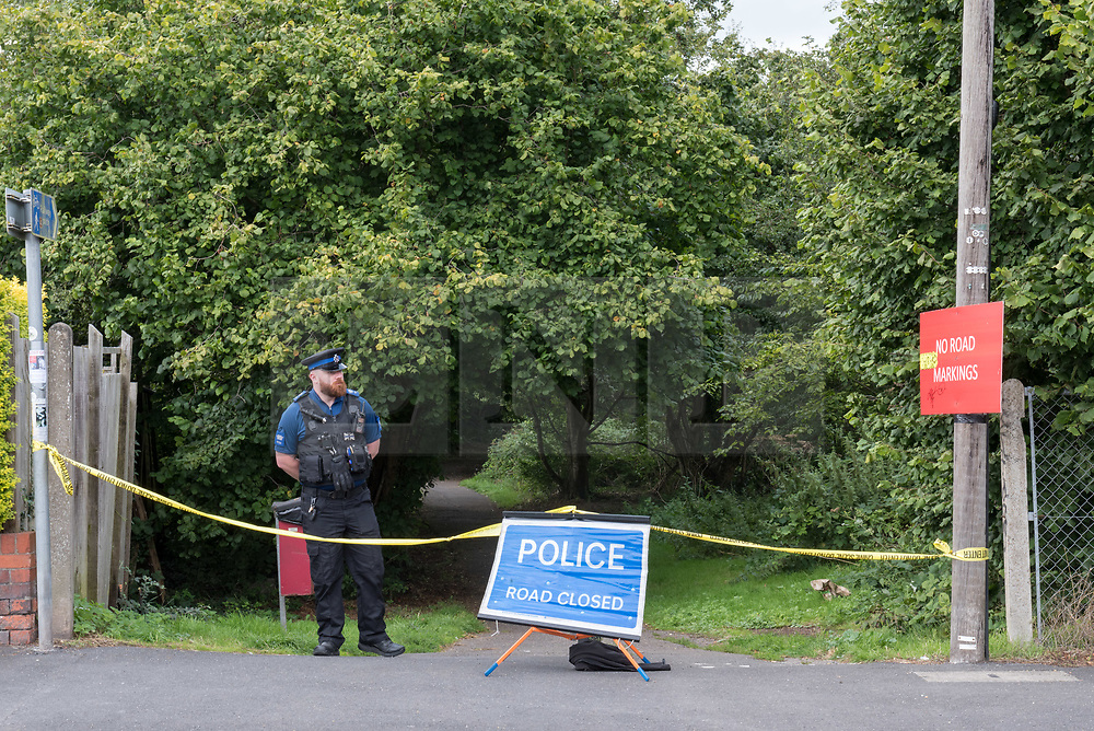 © Licensed to London News Pictures. 21/08/2019; Bristol, UK. Police cordons around the scene of an incident which occurred last night when a police officer was seriously injured while arresting someone allegedly for drugs. The officer is stable in hospital and will undergo surgery for severe facial injuries. A police statement says that about 7pm yesterday (August 20), a suspicious vehicle was seen by officers outside a building supplies company in Staple Hill. The car drove off and was spotted by officers a short time later in Kensington Road. When officers approached the vehicle, the three occupants got out and ran off in different directions. One of the suspects was seen heading along a footpath off Acacia Road and an officer chased after him. While detaining the suspect the officer has suffered some severe facial injuries. He was taken to hospital where he will undergo surgery. He is in a stable condition. Two arrests have been made. A 20-year-old man has been arrested on suspicion of possession with intent to supply a class A drug and a 37-year-old man has been arrested on suspicion of being concerned in the supply of controlled drugs. A quantity of suspected class A drugs and other items including cash and mobile phones have been recovered from the scene and the car has been seized for a full forensic examination. Photo credit: Simon Chapman/LNP.