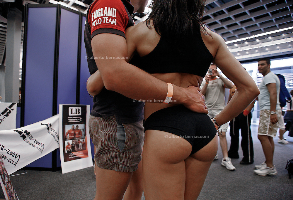 Italy, Florence, Fortezza da Basso, Fitfestival, photo souvenir with a  woman bodybuilder