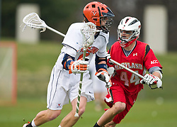 Virginia Cavaliers A Steele Stanwick (6) is defended by Maryland Terrapins LSM/Defense Brett Schmidt (44).  The #9 ranked Maryland Terrapins fell to the #1 ranked Virginia Cavaliers 10 in 7 overtimes in Men's NCAA Lacrosse at Klockner Stadium on the Grounds of the University of Virginia in Charlottesville, VA on March 28, 2009.