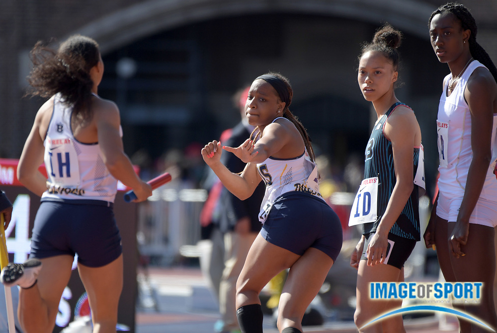Apr 26, 2018; Philadelphia, PA, USA; Shaniya Hall prepares to take the handoff from Lauryn Harris on the anchor of the Bullis (Md.) girls 4 x 400m relay that won its heat in 3:42.42 during the 124th Penn Relays at Franklin Field.
