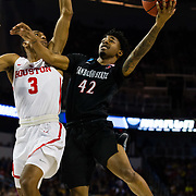 15 March 2018: San Diego State Aztecs guard Jeremy Hemsley (42) goes up for a contested layup while being defended by Houston Cougars guard Armoni Brooks (3) in the first half. The San Diego State Aztecs got knocked out in the first round by Houston on a last second layup to lose 67-65  at Intrust Bank Arena in Wichita, Kansas.