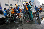 Peace boat volunteers take part in the clean-up operations in Ishinomaki, Miyagi Friday May 6th 2011. Around 350 volunteers took part in the relief effort over the Golden Week holiday, including 41 foreigners, clearing mud and removing debris from this coastal town which more almost levelled in the March 11th earthquake and tsunami.