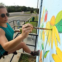 Belle Naugher, Director of the GumTree Museum of Art, works on painting a mural on the storm shelter on Front Street in Tupelo Wednesday. The project, started by Tupelo Ward 4 Councilwomen Nettie Davis, is to beautify the shelter in conjunction with Keep Tupelo Beautiful.