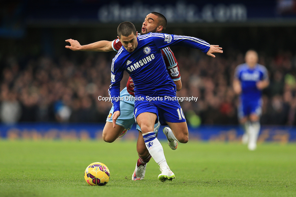 26 December 2014 - Barclays Premier League - Chelsea v West Ham - Eden Hazard of Chelsea tangles with Winston Reid of West Ham - Photo: Marc Atkins / Offside.