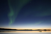 I love this image because it doesn't look real.  The water's too calm; the aurora too random; the light of the horizon too perfect.