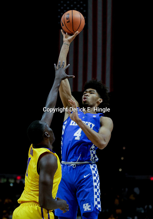 Jan 3, 2018; Baton Rouge, LA, USA; Kentucky Wildcats forward Nick Richards (4) shoots over LSU Tigers forward Duop Reath (1) during the first half at the Pete Maravich Assembly Center. Mandatory Credit: Derick E. Hingle-USA TODAY Sports