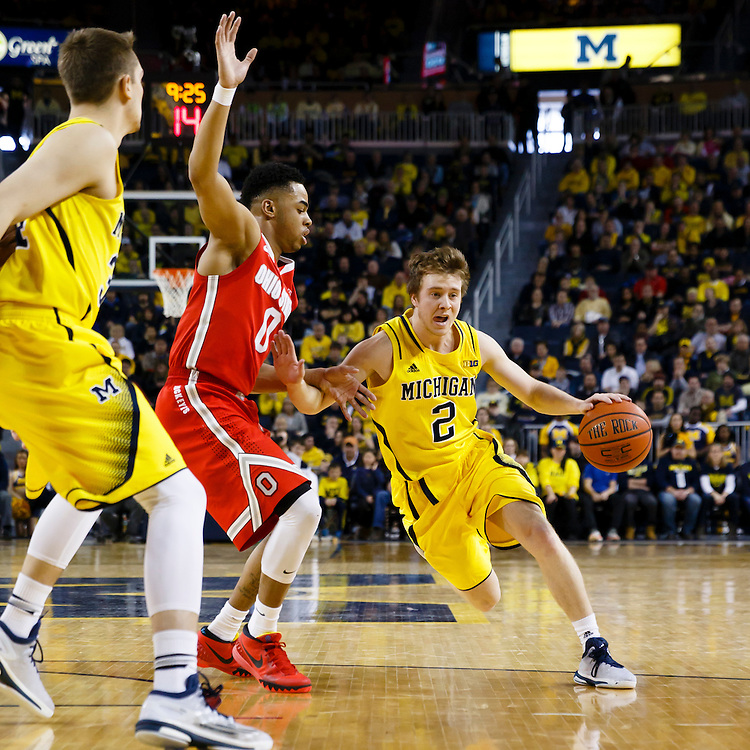 Feb 22, 2015; Ann Arbor, MI, USA; Michigan Wolverines guard Spike Albrecht (2) dribbles the ball down the court is guarded by Ohio State Buckeyes guard D'Angelo Russell (0) in the first half at Crisler Center. Mandatory Credit: Rick Osentoski-USA TODAY Sports