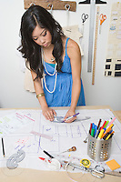 Female fashion designer working at desk