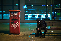 © Licensed to London News Pictures . 07/04/2017 . Manchester , UK . A man , believed to be suffering the effects of Spice , sits slumped on his side on a bench in Piccadilly . Greater Manchester Police have authorised dispersal powers and say they will ban people from the city centre for 48 hours , this evening (7th April 2017) , in order to tackle alcohol and spice abuse . Photo credit : Joel Goodman/LNP