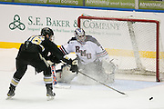 Robert Morris goaltender Terry Shafer stops a shot against Army forward Brendan McGuire during the Atlantic Hockey Semifinal in Rochester on Friday, March 18, 2016.