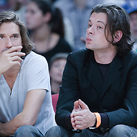 06 October 2010: French singer Benjamin Biolay (right) is seen during the Minnesota Timberwolves 106-100 victory over the New York Knicks, during 2010 NBA Europe Live, at the POPB Arena in Paris, France.