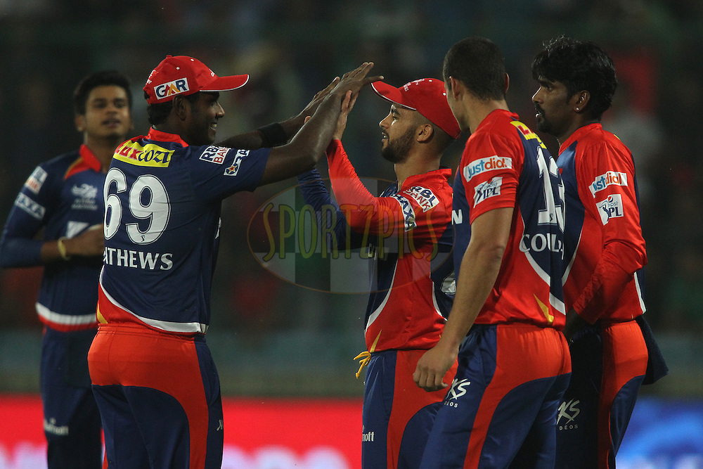 Angelo Mathews of the Delhi Daredevils congratulates Delhi Daredevils captain Jean-Paul Duminy for taking the catch to get Lendl Simmons of Mumbai Indians wicket during match 21 of the Pepsi IPL 2015 (Indian Premier League) between The Delhi Daredevils and The Mumbai Indians held at the Ferozeshah Kotla stadium in Delhi, India on the 23rd April 2015.<br /> <br /> Photo by:  Shaun Roy / SPORTZPICS / IPL