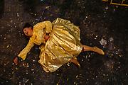 Caption: Yenny Wilma Maraz, alias Martha La Altena, knocked down on the floor, complains of pain due to several blows received during a wrestling match. The Cholitas wear the traditional costumes of Aymara people during wrestling shows in El Alto, Bolivia, February 26, 2012.<br /> SPANISH: Yenny Wilma Maraz, alias Marta La Alteña derribada al piso se queja del dolor por una serie de golpes que recibio de su adversario durante su enfrentamiento de lucha libre. Las Cholitas usan el vestido tradicional de los Aymara para luchar en el cuadrilatero, en El Alto, Bolivia, el 26 de Febrero de 2012.