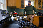 PORTLAND - MAY 23:  A Musician Eric Stern waits for water to boil in his kitchen May 23, 2014 in Portland, Or. Oregon health officials ordered Portland to issue a boil-water alert after three separate samples tested positive for E. coli. The presence of total coliform is a red flag, and E. coli indicates feces, says Kari Salis, regional manager of drinking water for the Oregon Health Authority.  (Photo by Natalie Behring/Getty Images)