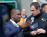 Chris Powell manager of Huddersfield Town and Paul Clement manager of Derby County during the Sky Bet Championship match at the John Smiths Stadium, Huddersfield<br /> Picture by Graham Crowther/Focus Images Ltd +44 7763 140036<br /> 24/10/2015