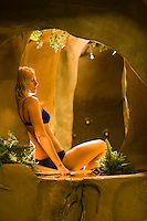 A young woman relaxes and enjoys a hydropath treatment in one of the Comox Valley's spa resorts.  Comox Valley, Vancouver Island, British Columbia, Canada.